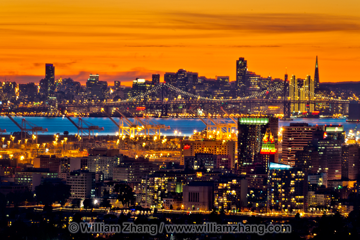 San Francisco skyline at sunset viewed from hills. Oakland, CA