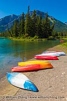 Bow River in Banff with boats along shore. Alberta, Canada