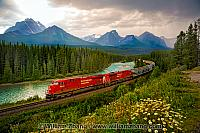 Freight train at Morant's Curve along Bow River. Banff, Alberta