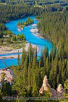 Bow River snakes past trees and hoodoos. Banff, Alberta, Canada