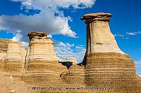 Hoodoo towers meet clouds and sky near Drumheller. Alberta