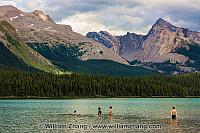 Four kids brave the icy water of Maligne Lake in Jasper NP