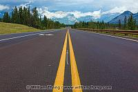 Canadian highway with views of peaks and clouds. Alberta