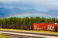 Rainbow and train tracks in Jasper townsite. Alberta