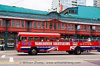 Tour bus and Sam Kee Building in Vancouver. BC, Canada
