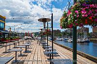 Restaurant tables and flowers on Granville Island. BC, Canada