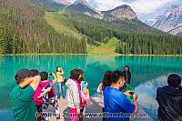 Visitors take photos of Emerald Lake at Yoho National Park. BC