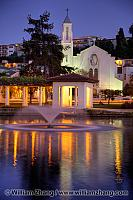 Church and lights reflect by fountain in Lake Merritt. Oakland,