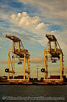Clouds and two jumbo container cranes at port. Oakland, CA