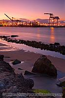 Container cranes across harbor from Alameda at port. Oakland, CA