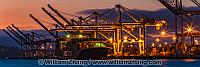 Night panorama of port with cranes and container ship. Oakland,
