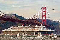 Queen Mary 2 sails under Golden Gate Bridge. San Francisco, CA